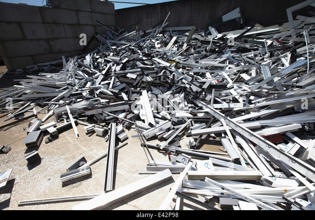 Heap of aluminium parts in scrap yard - Stock Image
