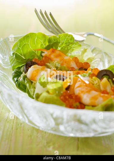 Shrimp,salmon roe and olive salad - Stock Image