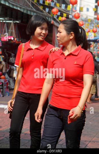 Thailand Bangkok Samphanthawong Chinatown Mangkon shopping market marketplace Asian woman friend friends - Stock Image