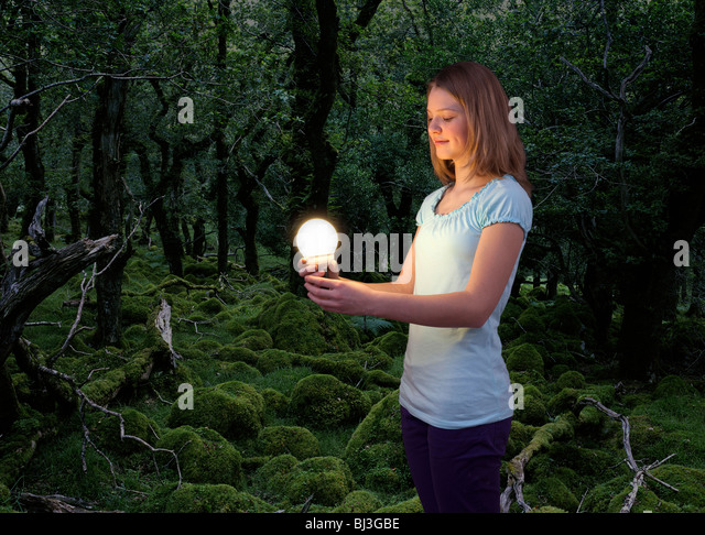 girl with energy saving light bulb - Stock Image