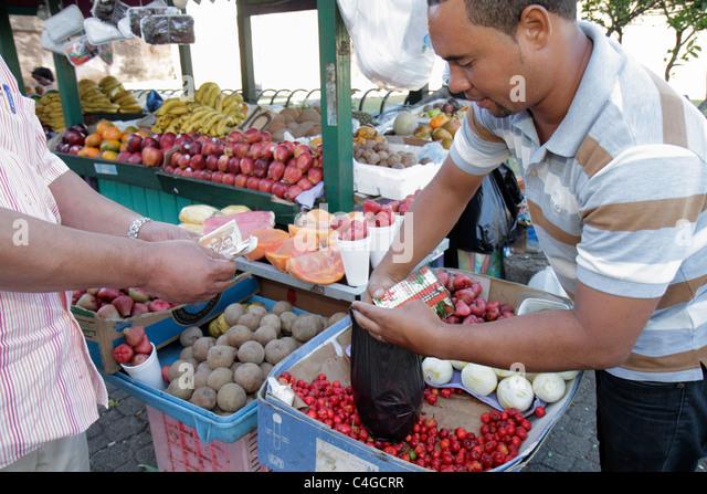 Santo Domingo Dominican Republic Ciudad Colonia Calle Las Mercedes fruit stand market vendor business buy sell cherries - Stock Image