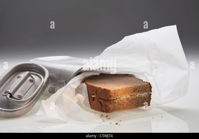 Bread and butter in lunch box - Stock Image