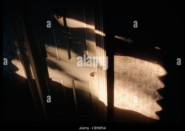 Sunlight and shadows on the interior door of a Victorian bed & breakfast inn, Edgartown, Martha's Vineyard - Stock Image