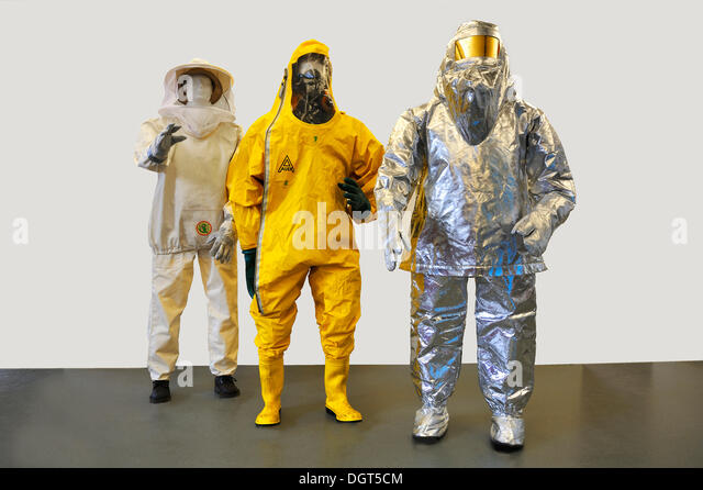 Three contemporary suits from the fire department, insect protective clothing, a chemical protective suit with a - Stock Image