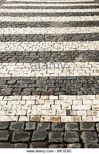 pedestrian crossing on a cobblestone street - Stock-Bilder