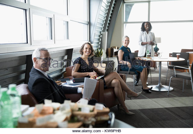 Confident business people meeting in business lounge - Stock Image