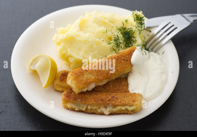 Fish fingers with mashed potatoes - Stock Image