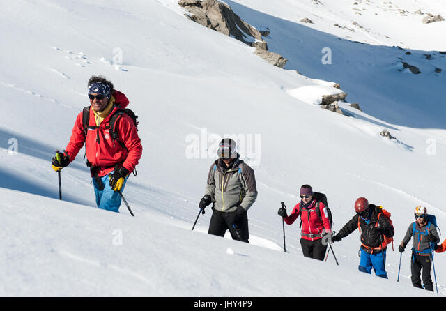 Sherpa from Nepal during a ski training camp in Disentis, Switzerland - Stock Image