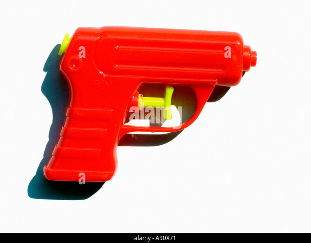 Red Plastic Water Gun Against a White Background Copy Space - Stock Image