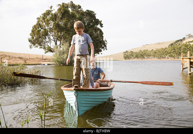 Family with rowing boat - Stock Image