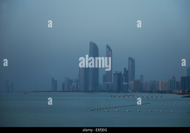 United Arab Emirates, Abu Dhabi, Skyline at dusk - Stock Image