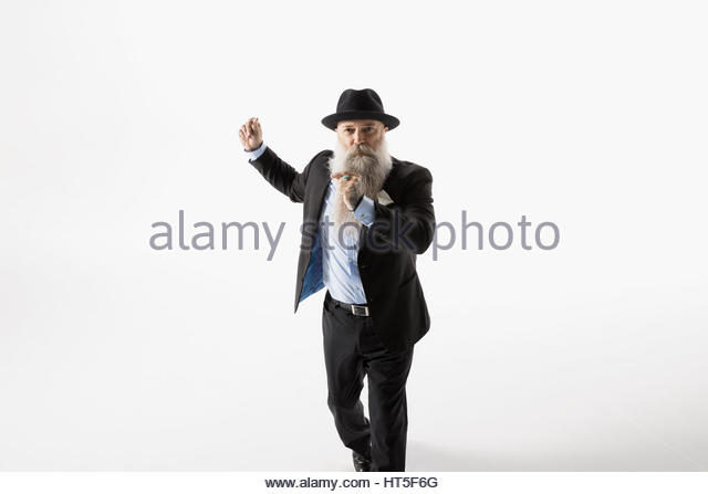 Portrait cool hipster businessman with beard dancing against white background - Stock-Bilder