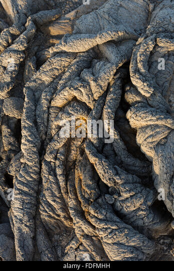 Twisted pahoehoe lava formations at Erta Ale volcano in Ethiopia, where the crust has wrinkled as the lava below - Stock Image