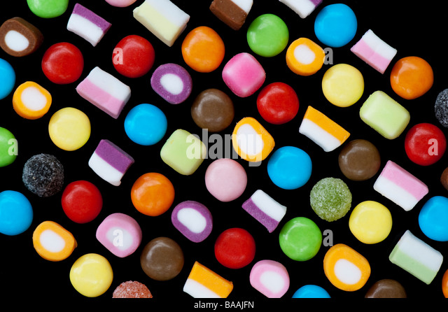 Multicoloured dolly mixtures Sweets pattern on black - Stock-Bilder