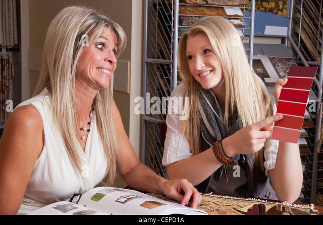 mother and daughter discussing colours and samples for remodelling of home; edmonton, alberta, canada - Stock Image