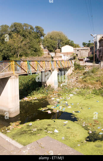 Pollution ; river turns into garbage dump ; people throw rubbish in river karh at Sasvad village ; taluka Purandar - Stock Image