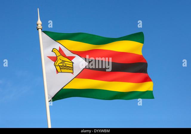The national flag of the Republic of Zimbabwe - Stock Image