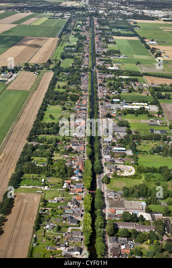 The Netherlands, Musselkanaal. Houses and businesses at both sides of canal. Aerial. - Stock Image