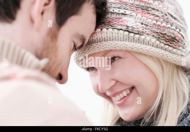 Couple standing face to face - Stock Image