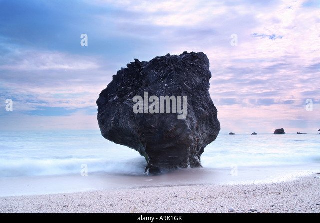 an unusual rock formation  shaped by the sea - Stock Image