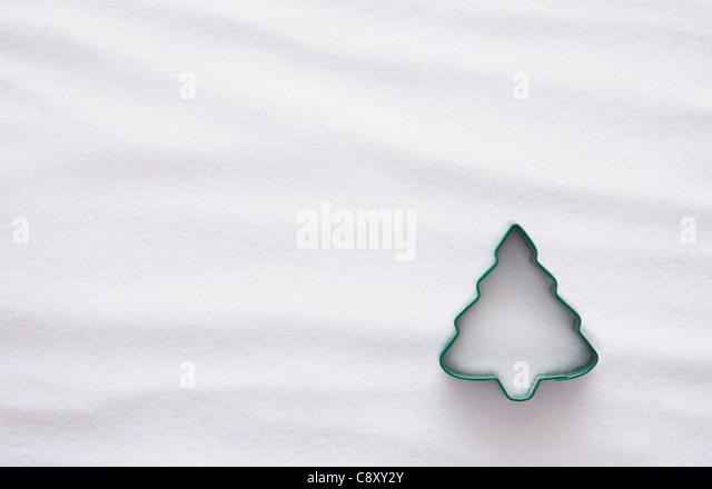 Pastry cutter in christmas tree shape against white backgrounds - Stock-Bilder