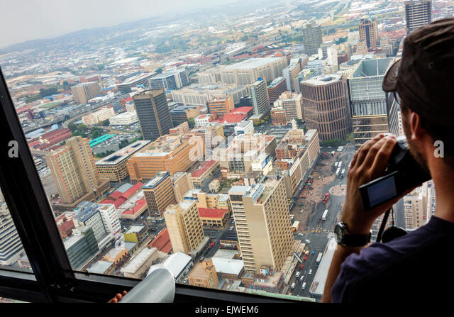 South Africa African Johannesburg Carlton Centre center Top of Africa observatory deck view from man looking buildings - Stock Image