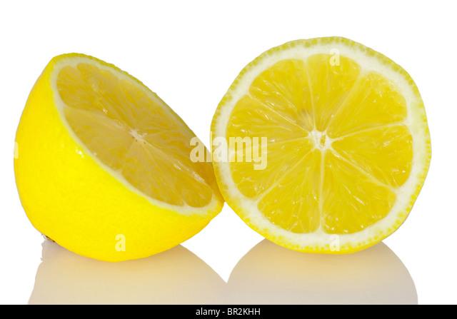 Lemon half and round slice macro on a white background - Stock Image