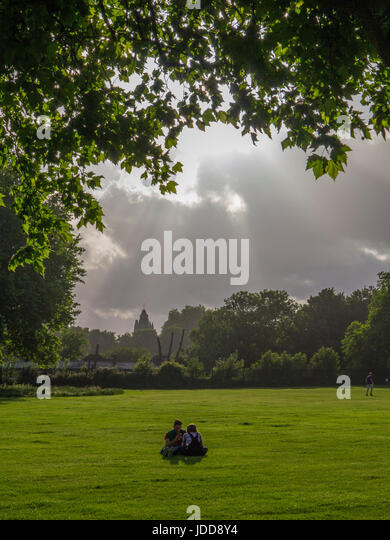 Relaxing in a London park - Stock Image