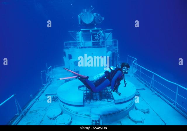 Cayman Brac woman scuba diver underwater on Wreck of Tibbetts Cayman Islands - Stock Image