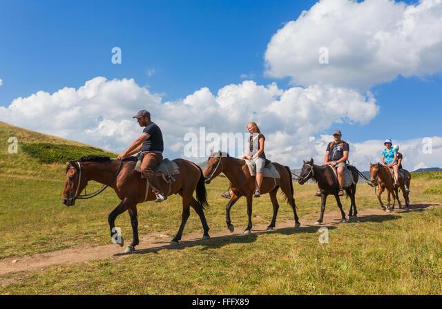 Horseback riding, Valley of seven lakes, Caucasus mountains, Abkhazia, Georgia - Stock Image