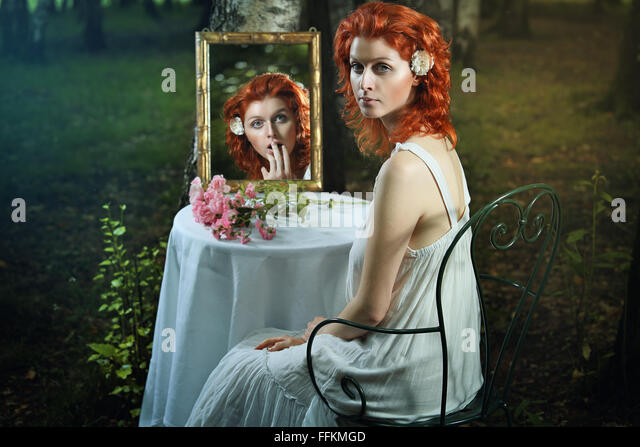 Shocked expression in a strange mirror . Surreal and fantasy concept - Stock-Bilder