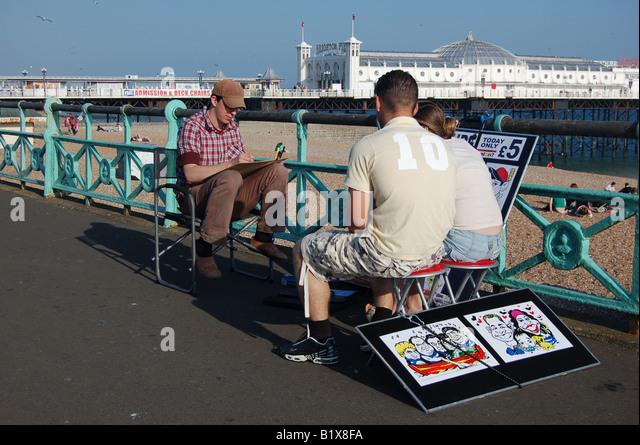 Artist at work, Brighton seafront, England - Stock Image