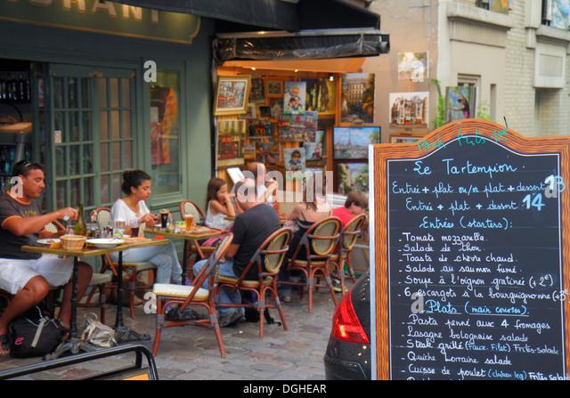 Paris France Europe French 18th arrondissement Montmatre Place du Tertre restaurant cafe brasserie tables chairs - Stock Image