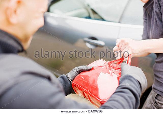 Mugger Stealing Handbag - Stock Image