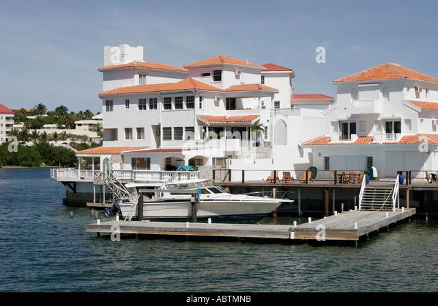 Sint Maarten Dutch Simpson Bay Lagoon waterfront homes apartments boat yacht dock - Stock Image