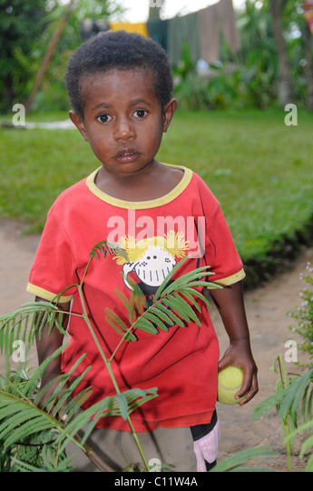 Dani boy in a T-shirt, Wamena, Irian Jaya or West Papua, New Guinea, Indonesia, Southeast Asia - Stock Image