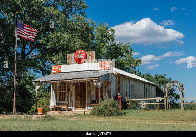 Restored wooden gas station or store from the early 20th century still displaying old style Coke-a-Cola signs and - Stock Image