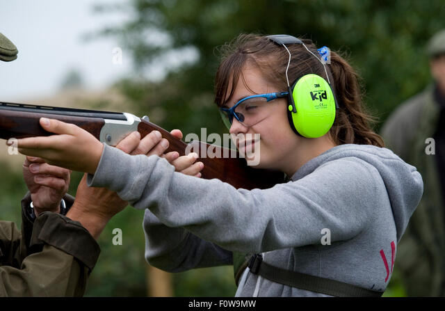 child having a shooting lesson - Stock Image