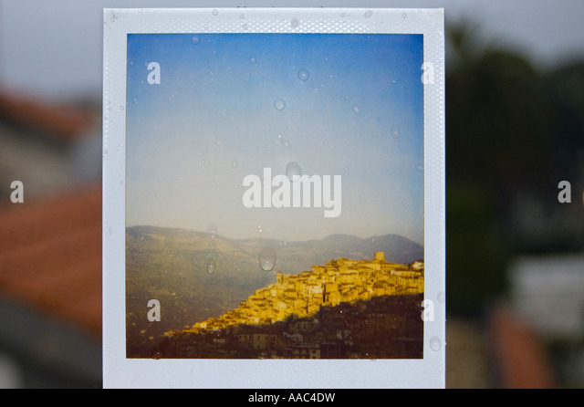 polaroid of a small village in italy - Stock Image
