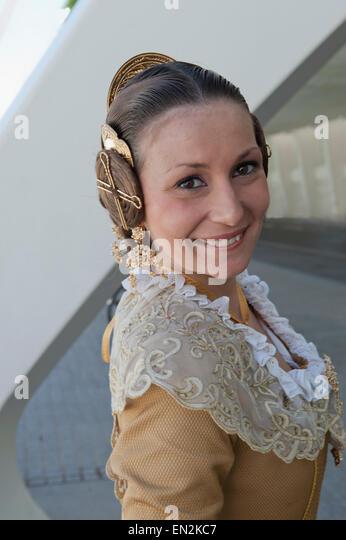 Female in traditional Falla dress Valencia Fallas de Valencia smiling fiesta portrait Falleras lady girl Spanish - Stock Image