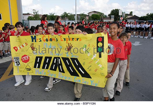 Miami Florida Spanish Lake Elementary School International Walk to School Day student safety poster contest parade - Stock Image