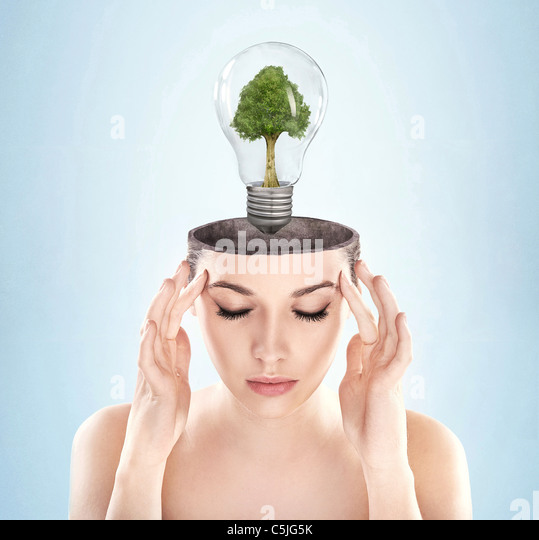 Open minded woman with green energy symbol - Stock Image