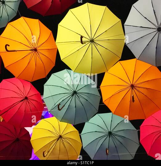Floating umbrellas - Stock Image