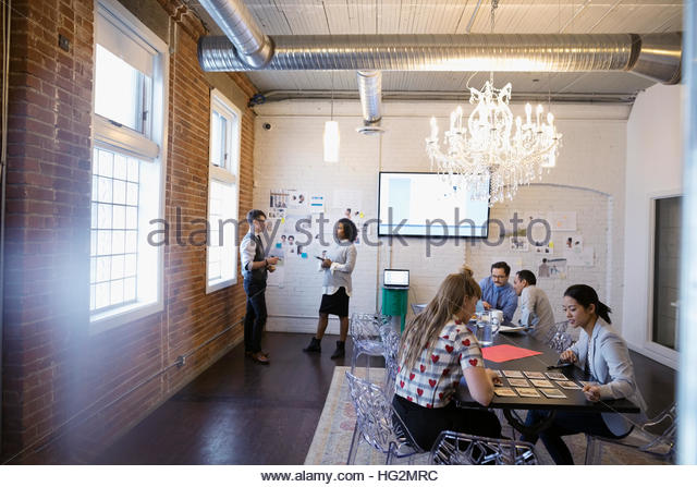 Designers meeting brainstorming in conference room - Stock Image