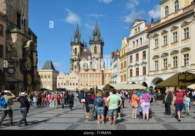 Tourists at the Old Town Square of Prague in the Czech Republic. - Stock Image