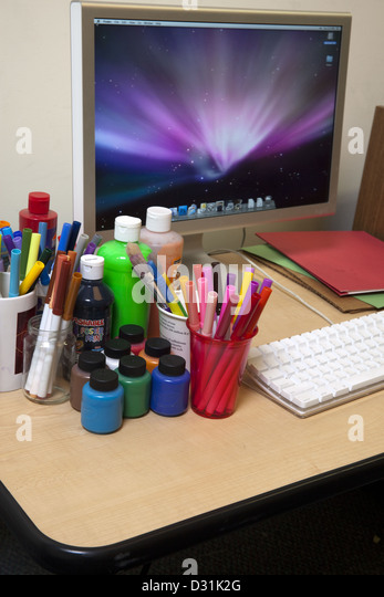Illustrator art supplies and computer - Stock Image