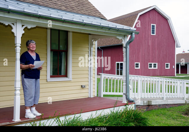 Indiana Portage Countryside Park Alton Goin Historical Museum regional history restore Samuelson farmhouse woman - Stock Image