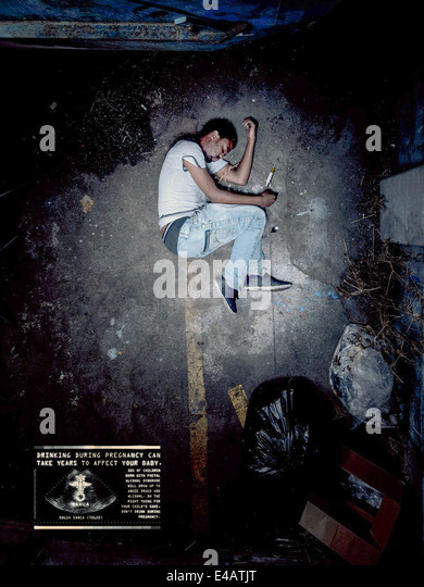 SANCA 2010 fetal alcohol syndrome awareness campaign poster. Drug addict in fetal position. See description for - Stock Image