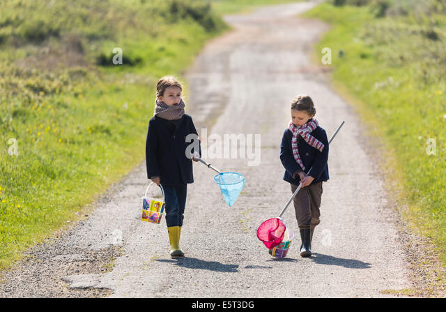 4 and 6 year old sisters. - Stock Image