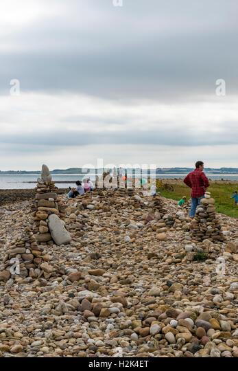 Holy Island rock piles - Stock Image